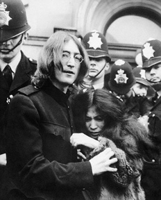 John lennon holds Yoko Ono